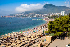 Montenegro beaches with a lot of people and sun umbrellas Stock Images