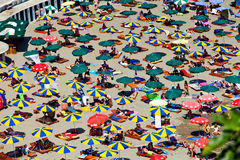 Montenegro beaches with a lot of people and sun umbrellas Royalty Free Stock Photography