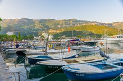 Fishermen and yachtsmen moored their vessels in a dock for overnight. Royalty Free Stock Image