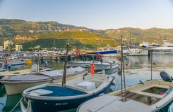 Fishermen and yachtsmen moored their vessels in a dock for overnight. Royalty Free Stock Photography