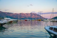 Fishermen and yachtsmen moored their vessels in a dock for overnight. Stock Images
