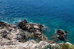 Montenegro coastline. Water splashing up against rocks along Montenegro coast Royalty Free Stock Image