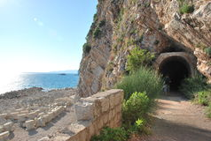 Montenegro. An entrance to the tunnel at the coast of the Adriatic Sea. The tunnel in the mountain at the coast of the Adriatic Sea. Montenegro. Petrovats Stock Photo