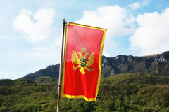 Montenegro flag in a front of mountains Stock Photography