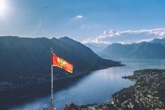 Montenegro Flag Over Kotor Bay in Montenegro stock image