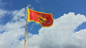 Montenegro flag on wind. A flag of Montenegro swinging on wind with sky in background Royalty Free Stock Photo