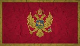 Montenegro flaga z skutkiem zmięty papier i grunge royalty ilustracja