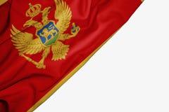 Montenegro flagga av tyg med copyspace f?r din text p? vit bakgrund stock illustrationer