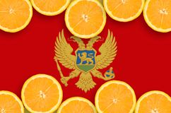Montenegro flagga i citrusfruktskivahorisontalram royaltyfri bild