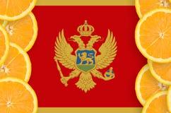 Montenegro flagga i vertikal ram för citrusfruktskivor royaltyfri foto
