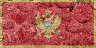 Montenegro flagga på en stenvägg stock illustrationer