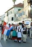 Montenegro, Herceg Nov - 28/05/2016: Folkloru zespół Rakalj od Chorwackiego miasteczka Rakalj z flaga państowowa Obrazy Stock