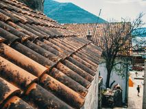 Montenegro, Herceg Novi. Tiled roofs of old town at background of the Adriatic Sea, mountains, cruise liner. royalty free stock photography
