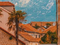 Montenegro, Herceg Novi. Tiled roofs of old town at background of the Adriatic Sea, mountains, cruise liner. stock photography