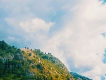 Montenegro, Herceg Novi. Tiled roofs of old town at background of the Adriatic Sea, mountains, cruise liner. royalty free stock image
