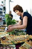 Montenegro, Herceg Novi - 18/06/2016: A woman prepare a table with treats for the guests Royalty Free Stock Photography
