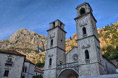 Montenegro Kotor church. Church in Kotor with majestic mountains in  Montenegro Royalty Free Stock Photos