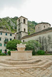 Montenegro Kotor church, fountain in the center one of old city. Buildings Royalty Free Stock Photo