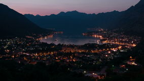 Montenegro Kotor panorama twilight time lapse zoom 4k. Evening view of the bay of Kotor in Montenegro. Time Lapse zoom stock video footage