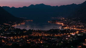 Montenegro Kotor panorama twilight time lapse zoom out 4k. Evening view of the bay of Kotor in Montenegro. Time Lapse zoom out stock footage