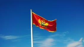 Montenegro national flag on the pole.  royalty free stock photos