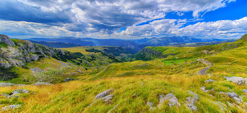 Montenegro, national park Durmitor, mountains and clouds panorama. Sunlight lanscape. Nature travel background.  Royalty Free Stock Photography