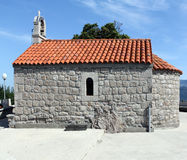 Montenegro. Old orthodox church on the mountain. Montenegro. The small orthodox church in honour of Iliya the Prophet on the top of mountain Stock Images