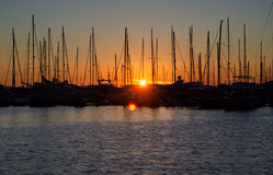 Montenegro's harbor on sunset, silhouettes of sailboat  in the p. Harbor on sunset, silhouettes of sailboat moored in the port in the evening Royalty Free Stock Photography