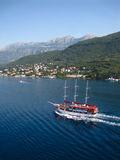 Montenegro. Scenic view of ship sailing in water surrounded by mountains Royalty Free Stock Photography