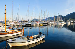 Montenegro small fishing boat. Small fishing boat on the front of the yachts royalty free stock images