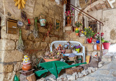 Montepulciano, Italy - August 26, 2013: Decorated facade of a stone house. Montepulciano, Italy - August 26, 2013: Decorate patio, with a porch in a small royalty free stock photography