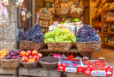 Montepulciano, Italy - August 18, 2013: Food stalls with different ripe fruits. Montepulciano, Italy - August 18, 2013: Street shop with different fresh and royalty free stock images