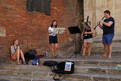 Street musicians in Tuscan town Montepulciano, Italy Stock Photos