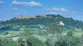 Montepulciano Skyline Tuscany Italy. Medium wide low angle high dynamic range shallow depth of field panning tracking slider shot during a sunny day in summer of stock video