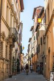 Montepulciano Tuscany Alleyway with Tourists. On a summer afternoon, featuring street lamps and alleyways stock images