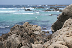 Monterey Pacific Ocean Shore. Rocky shore and surf along 17-Mile Drive on Northern California coast between Monterey and Carmel. Horizontal format Stock Photography