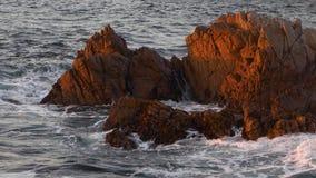 Monterey surf rocks loop stock video footage