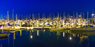 Sailing boats in the harbor by night Stock Image