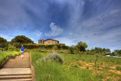 Monteriggioni, medieval village in Tuscany. Walking woman at Monteriggioni, medieval village in Tuscany Italy Royalty Free Stock Images