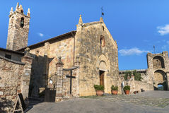 Monteriggioni, Tuscany. Monteriggioni in the Siena Province of Tuscanya, a medieval walled town, located on a natural hillock. The main piazza with the royalty free stock photography