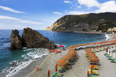 Monterosso al Mare, Cinque Terra, Italy. Italian Riveria Beach and Rows of Beach Chairs Monterosso al Mare, Cinque Terra, Italy Royalty Free Stock Image