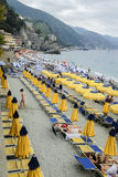 Monterosso Al Mare Cinque Terra Italy. Monterosso Al Mare, ITALY JULY 4th: Beach goers enjoying a beautiful day at the sea in the Cinque Terra region of the Stock Image