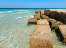 Concrete blocks wave breaker on Ionian sea coast , Salento, Italy. Concrete blocks wave breaker on Ionian sea coast near Gallipoli, Salento, Puglia, Italy Stock Photography