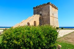Torre Lapillo, Salento sea coast, Italy. Picturesque historical fortification tower Torre Lapillo (St. Thomas Tower) Torre di San Tommaso on Salento Royalty Free Stock Image