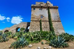 Torre Colimena on Salento sea coast, Italy. Picturesque historical fortification tower Torre Colimena on Salento Ionian sea coast, Taranto, Puglia, Italy Royalty Free Stock Photos