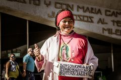 Smiling woman in Basilica of Guadalupe. MONTERREY, NUEVO LEON / MEXICO - 18 12 2017: Deaf-mute smiling woman asking for money in traditional Basilica de stock image