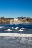 Montes da neve no rio congelado Imagem de Stock Royalty Free