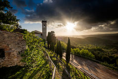 Montescudaio, Pisa, Tuscany, Italy, view of the ancient village. Montescudaio, Pisa, Tuscany, Italy, Panorama at sunset of the tower and church from the Castle Royalty Free Stock Images