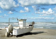 Old fishing boat on the beach. Montesilvano beach,Provice of Pescara,Abruzzo.Old fishing boat on the beach Royalty Free Stock Photography