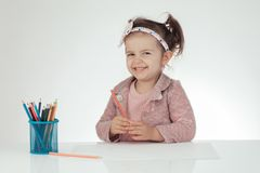Cute little girl learn to draw. Education. School. Montessori. Royalty Free Stock Images